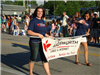 Women Carry the City of Wadsworth Cable and Internet Banner in Parade