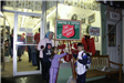 Little Kids Donate to The Salvation Army Bell Ringer Bucket