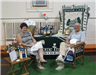 Man and woman sit at Home Instead Senior Care booth.