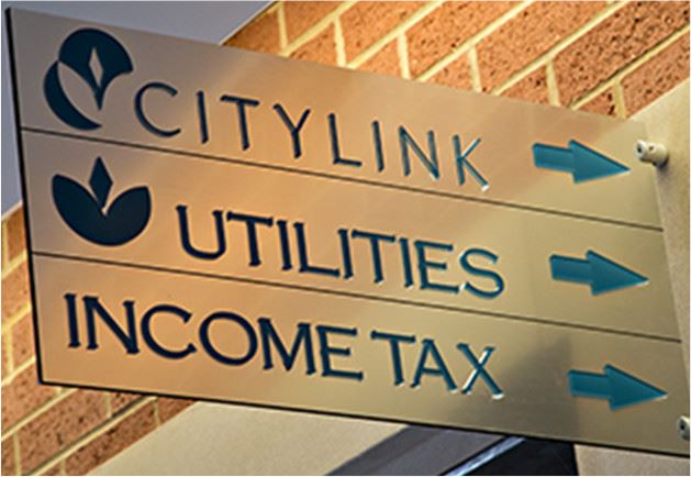 Office signs for CityLink Utilities and income tax