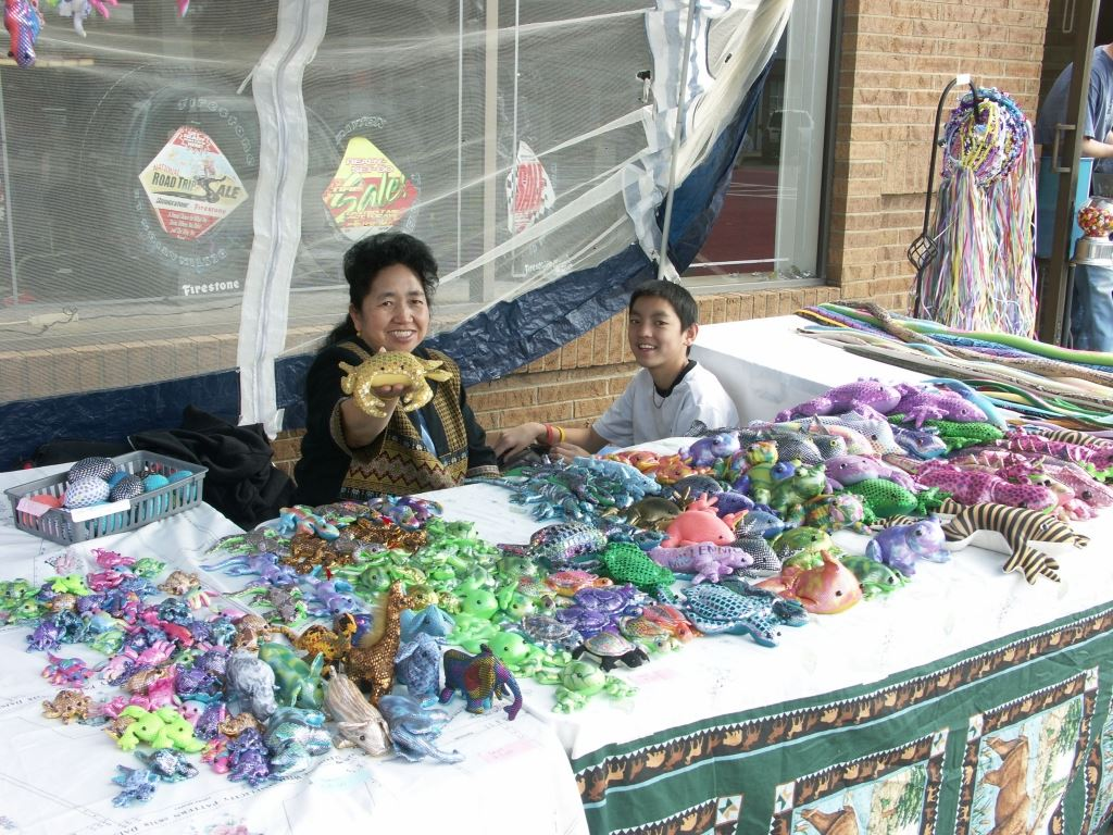Woman and Little Boy Selling Sand-Filled Animal Toys