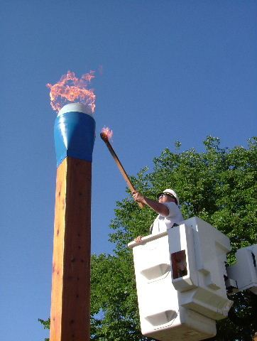 Man Lights the Oversized Blue Tip Match
