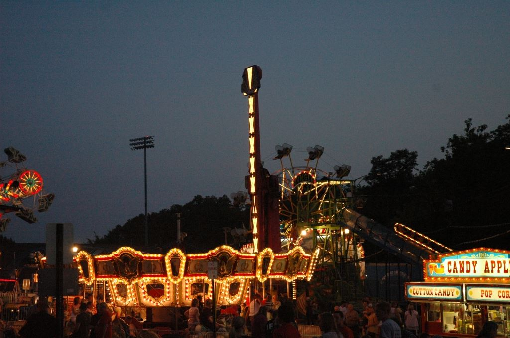 Carnival Rides in the Dimming Light of the Sky