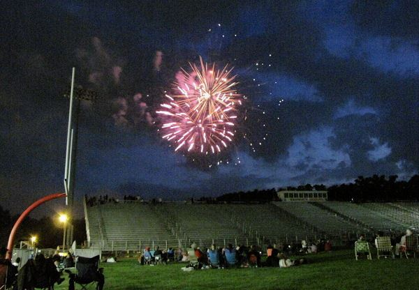 Crowd in Football Field Watches Firework Show