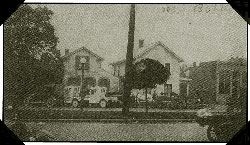 A black and white photo of a row of houses.