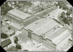 A black and white aerial photo of warehouses.